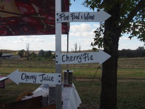 Signpost reads - Fine Food and Wine, Cherry Pie and Cherry Juice.