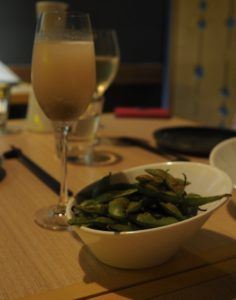 Bellinis and bowl of edamame