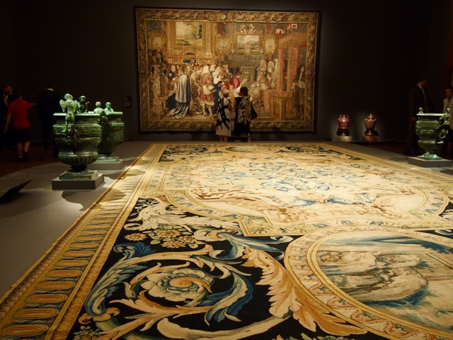 Large detailed floor carpet, and wall tapestry.
