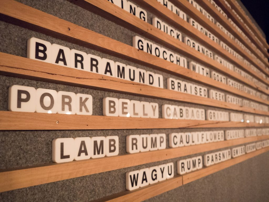 """The menu sit on the main wall, spelled out with individual letters"""