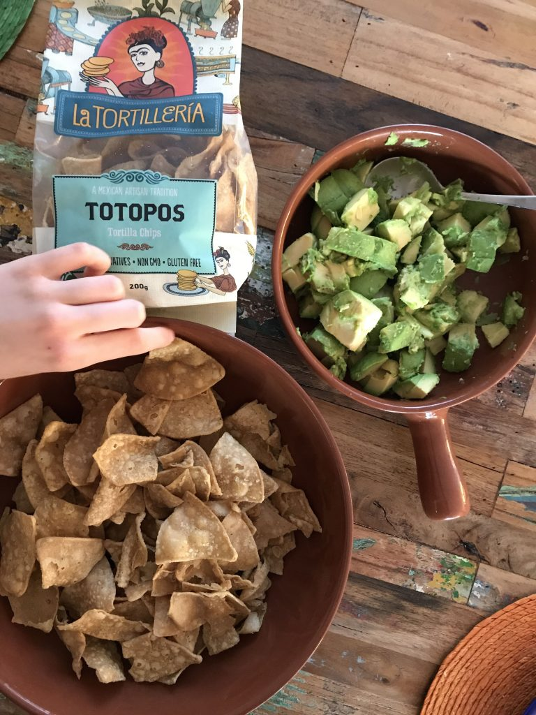 totopos (corn chips) and our rustic Guacamole.