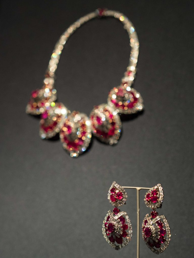Rubies and diamonds encrusted earrings with matching necklace and bracelet (not pictured)
