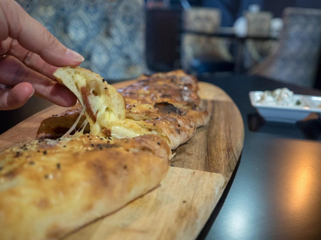 The cheese oozes out of the sujuk pide