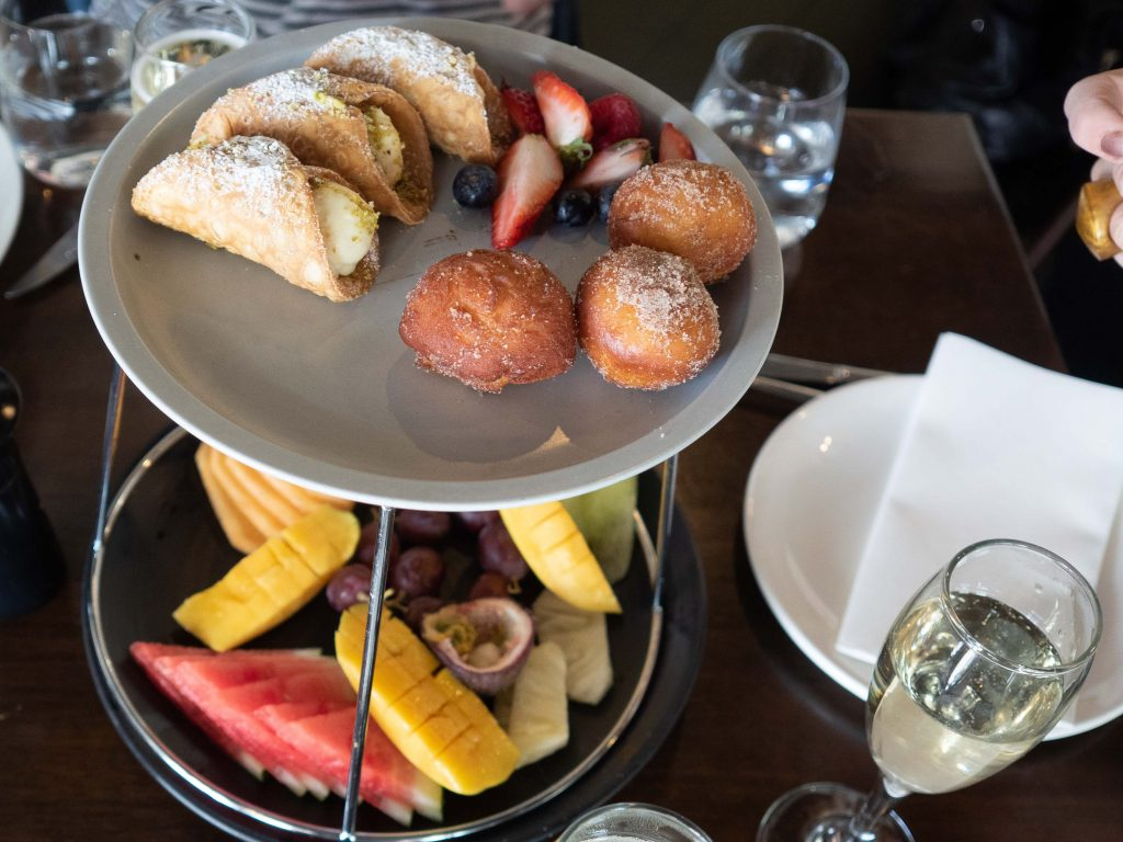 A degustation of fresh fruits accompanied by Italian pastries will satisfy the sweet cravings